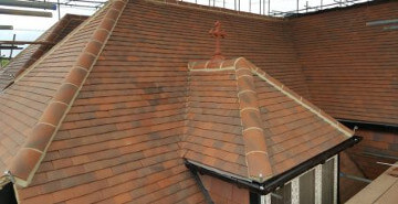Slate or tile roofs